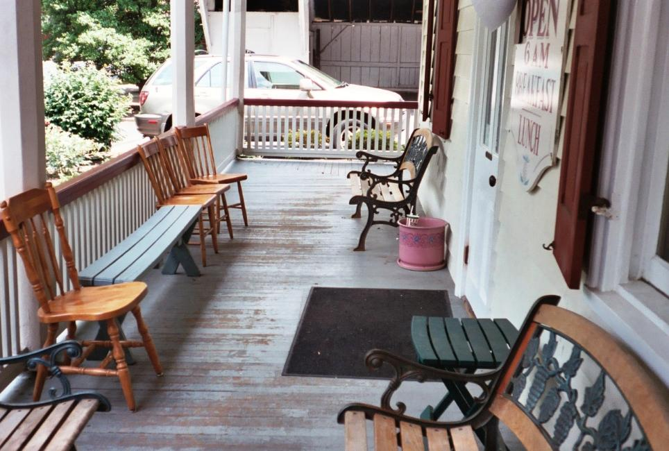 We haven't yet had to make use of this porch, but it looks like a comfortable place to wait for a table.
