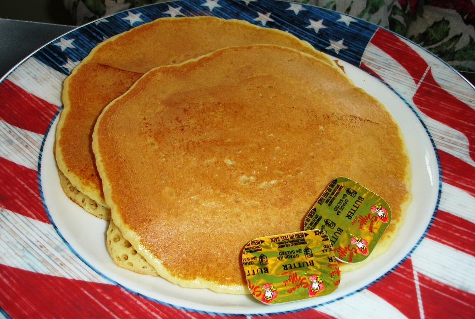 The pancakes are very thick, and they have a springy, sort-of-yeasted texture (though we doubt that's how they're made). A short stack should suffice for most.