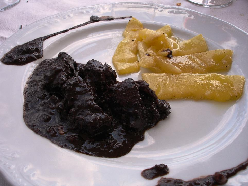 Cinghiale in Dolceforte con zucca marinata (ricetta rinascimentale a base di cioccolato, pinoli, uvetta e aceto balsamico): wild boar in Dolceforte with marinated pumpkin (Dolceforte is a Renaissance-era sauce made with chocolate, pine nuts, raisins and balsamic vinegar)