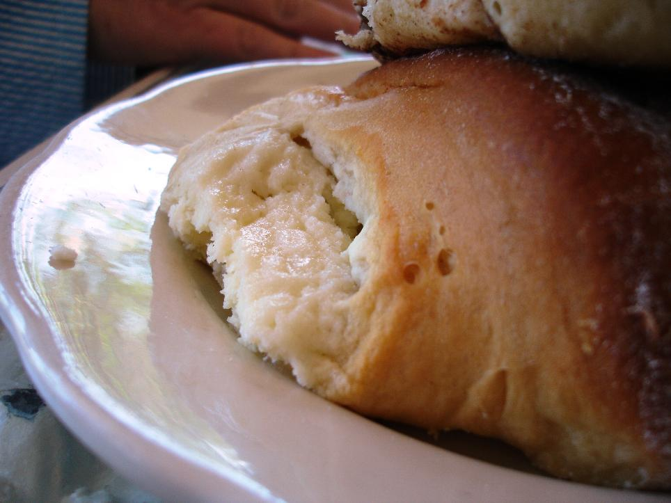 In this close-up side view of the cheese bread, you get a glimpse of the sweet vanilla cheesecake-like filling.