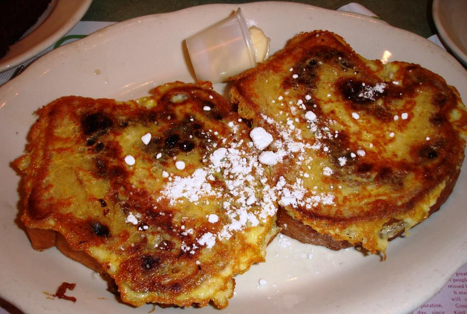 This is a short stack of cinnamon raisin French toast. The bread is thick and sweet - syrup not necessary, but go ahead if you like it super-sweet.