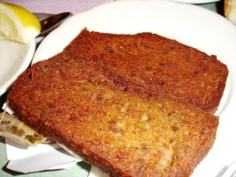 Scrapple is a Delaware Valley specialty. Many people like it with syrup. Mastoris' version is too livery for our tastes.