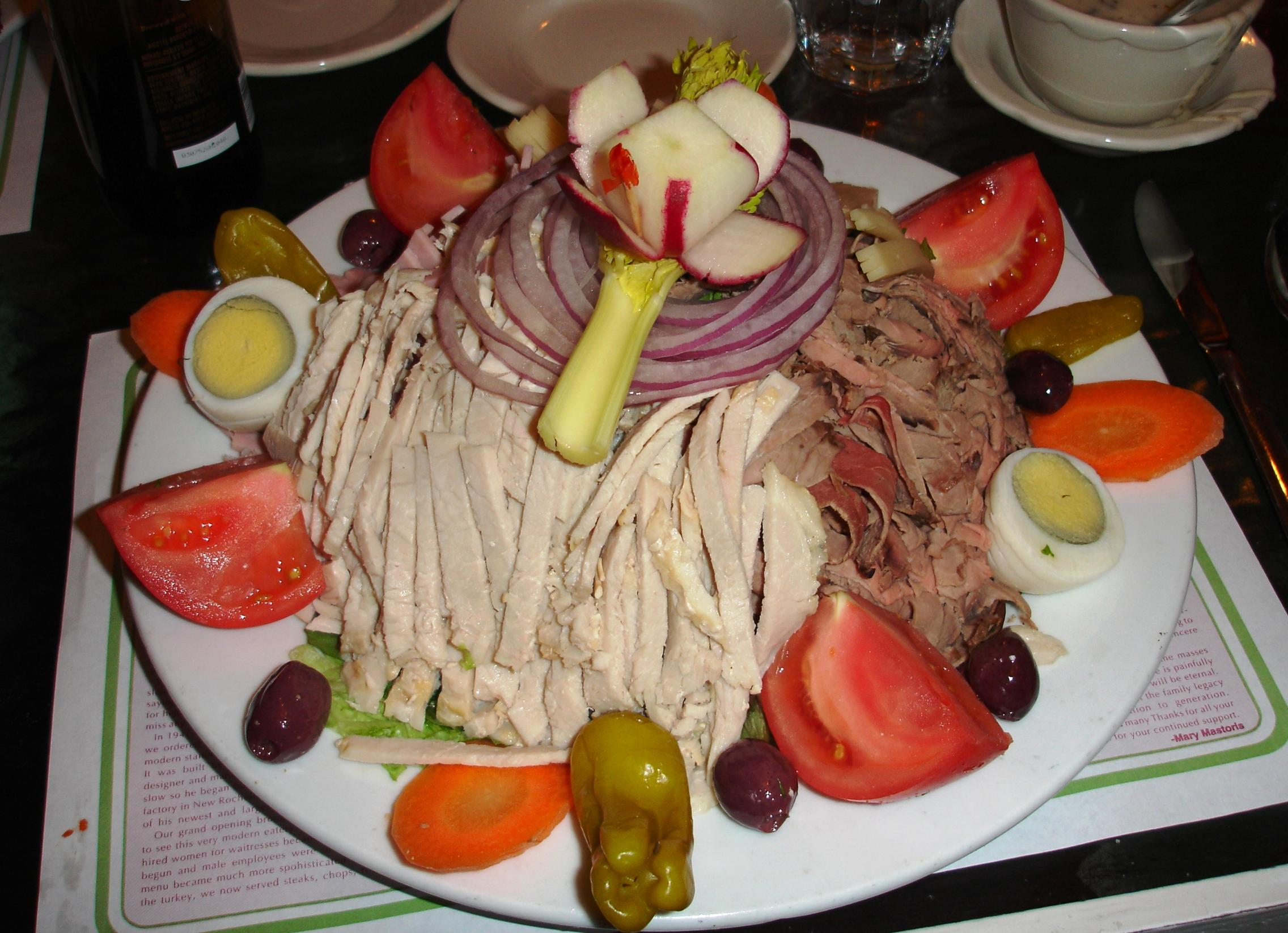 "The large chef's ""salad"" is one of the meatiest items on the long menu!"