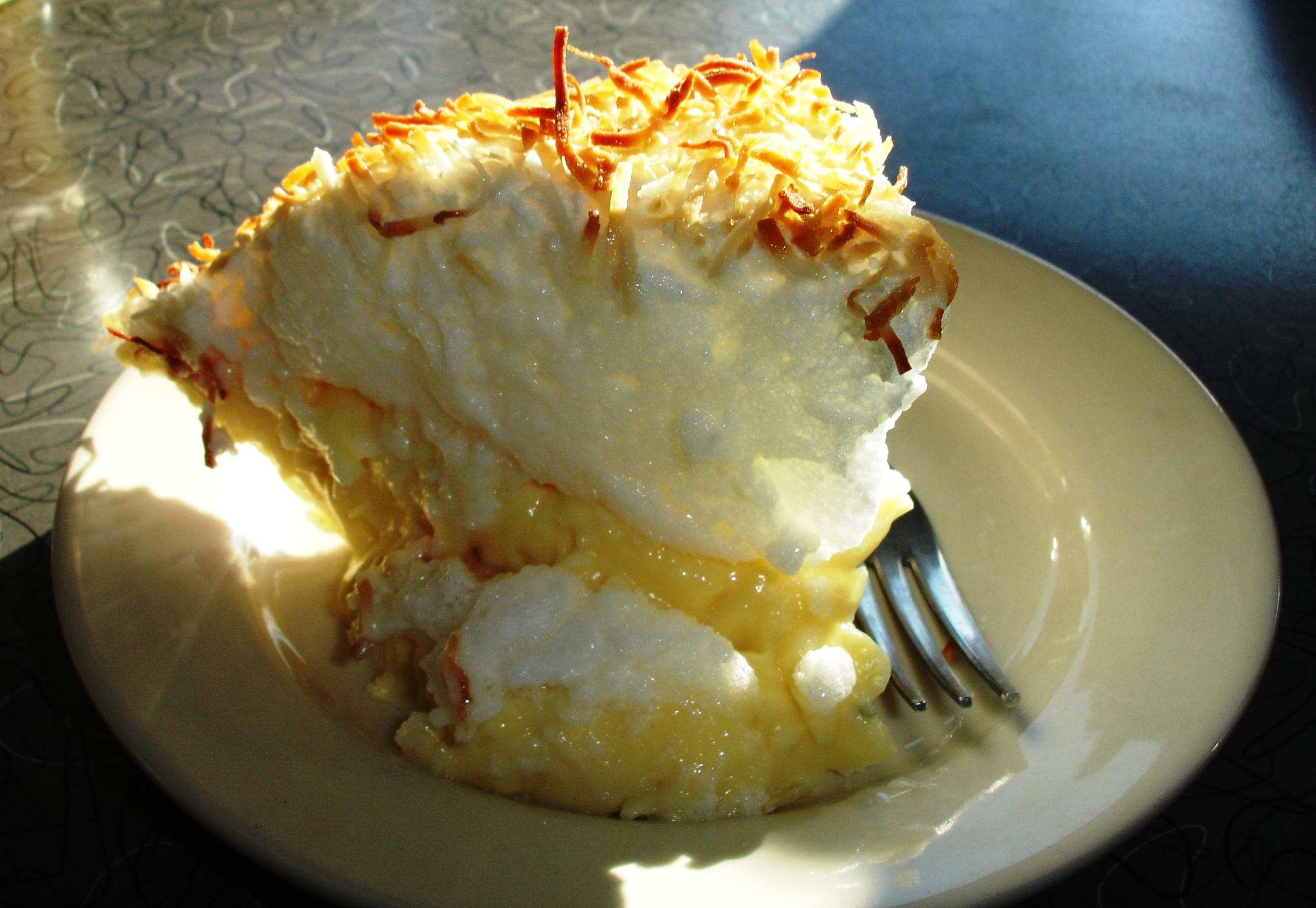 Pies, like this wedge of meringue-topped coconut cream, are made in-house.