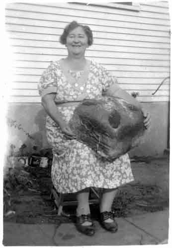 Here's Mrs. Trcka in the 1940s with her giant kolacky.