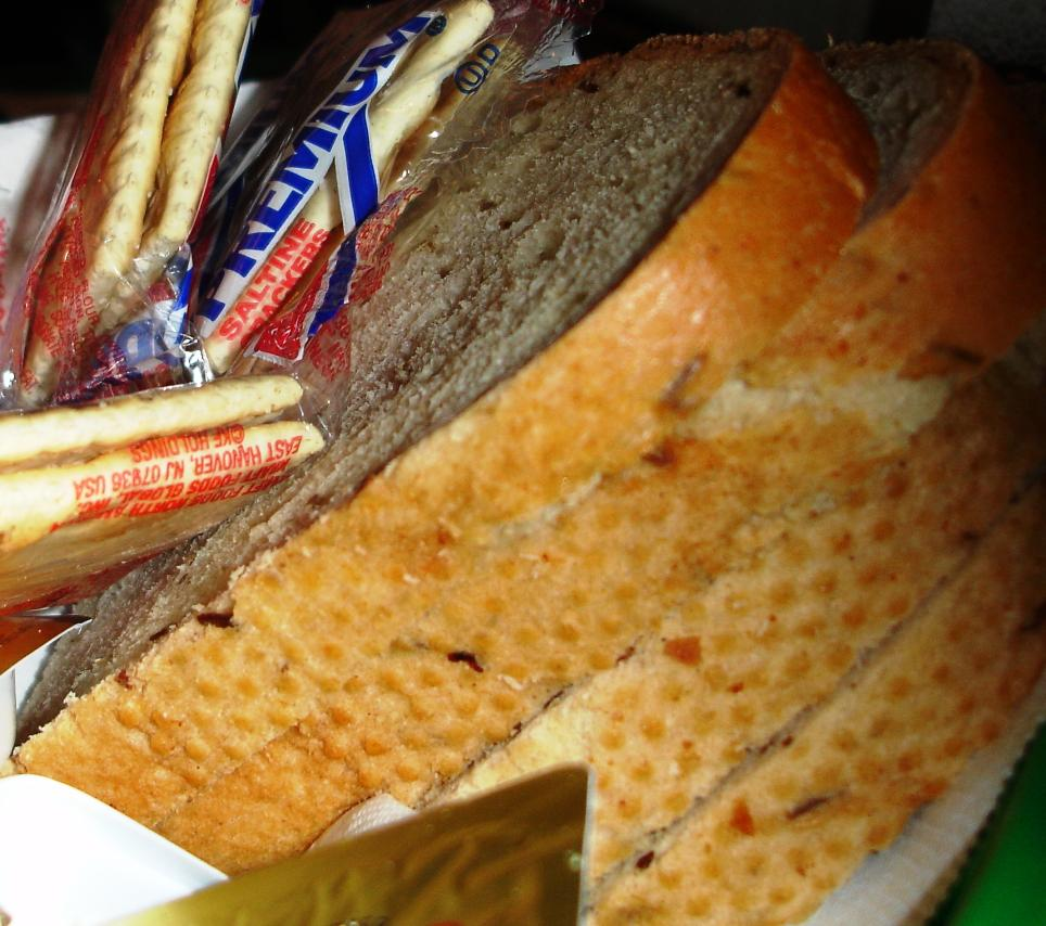 The bread basket holds slices of good fresh rye bread.