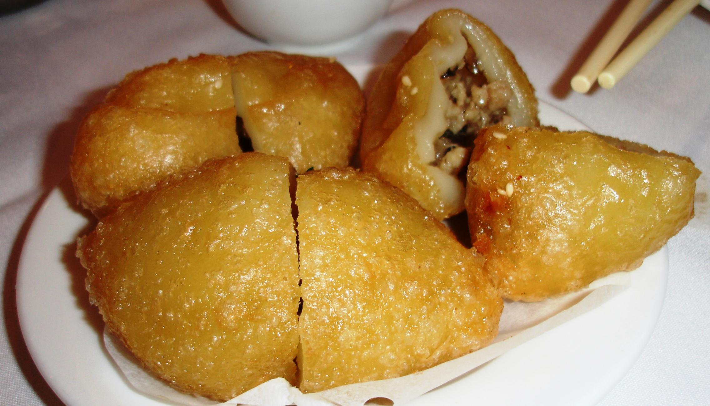 Fried glutinous rice dumplings have a sticky-chewy shell surrounding saucy pork and mushrooms.