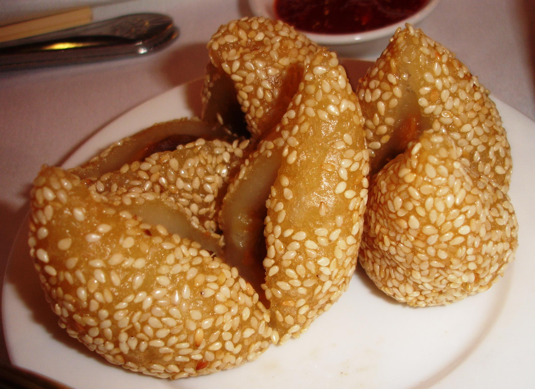 Fried sesame balls filled with a sweetened bean paste are a dessert.