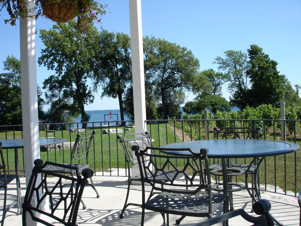 The outside tables are stunningly situated along rows of grapevines and within view of Lake Ontario.