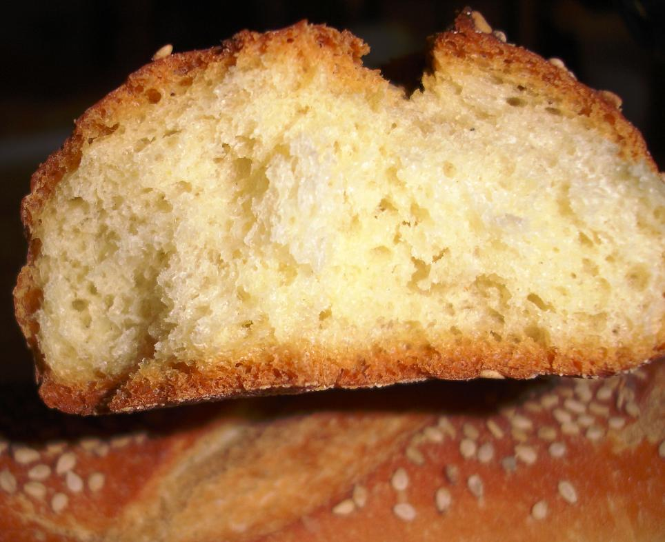 See the creamy yellow tight crumb and thick crust characteristic of semolina bread. We aren't particular fans of semolina bread in general: it has a little sweetness and density that we don't love, but Rose & Joe's makes a classic version.