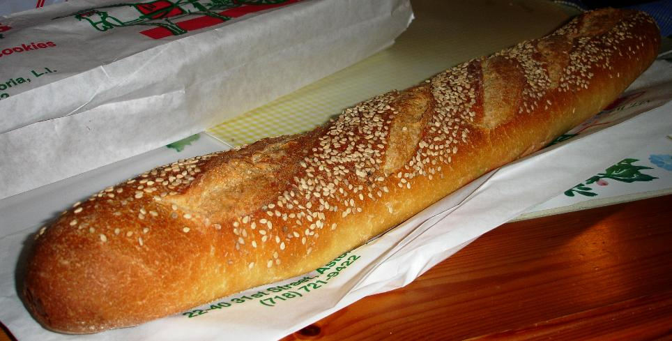 A loaf of old-fashioned sesame seeded Italian bread, perfect for turning into a hero sandwich