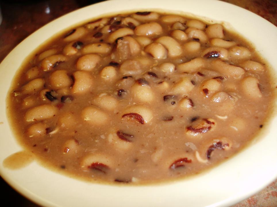 Black-eyed peas are served in their creamy cooking liquid.