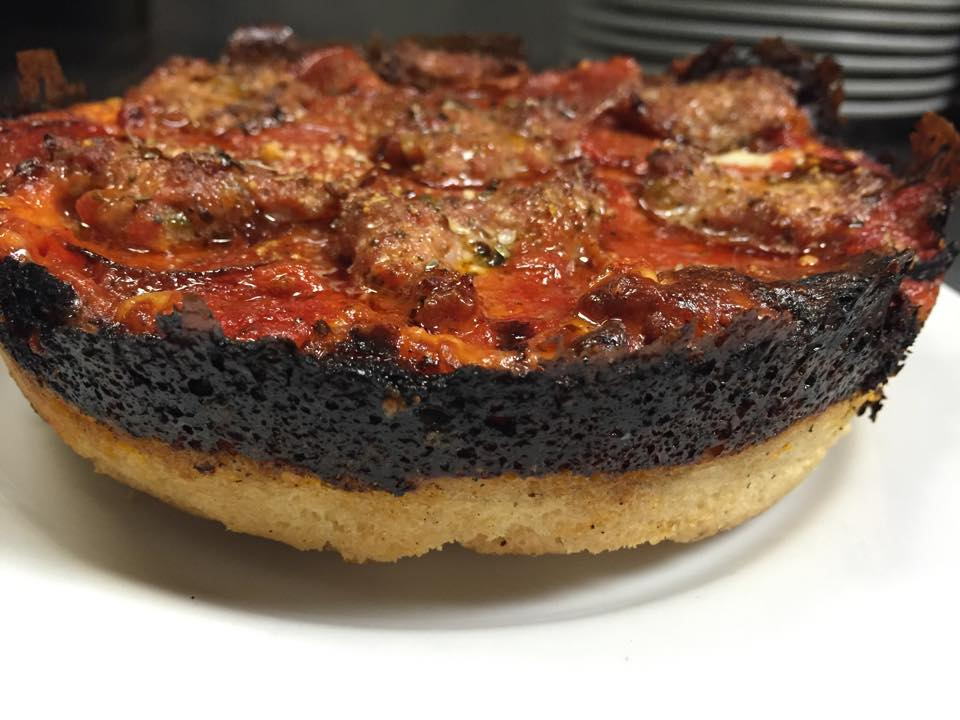 The signature crispy cheese ring around a Pequod's of Chicago pie